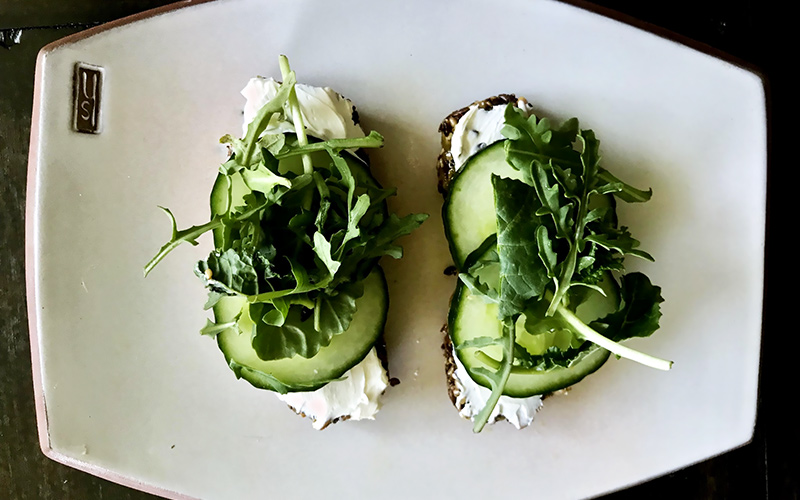 image of crackers with cucumbers and fresh greens